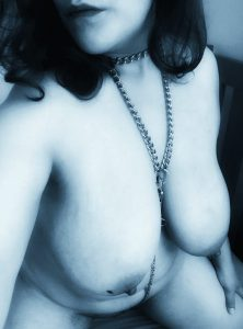 My edits on photo of me  kneeling wearing chains - blue tinge and glamourised